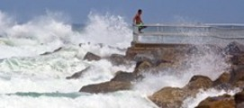 Thumbnail Man watches Hurricane Irene waves