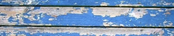 Flaking paint on wooden boards, web banner photo