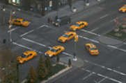 Thumbnail 7 Taxis at New York City intersection