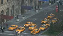 Thumbnail Group of yellow taxi cabs at NYC intersection
