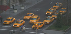 New York Taxis at a traffic light