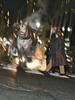 Thumbnail Horse-drawn carriage, pedestrians at night, NYC