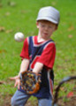 Little boy catching a baseball