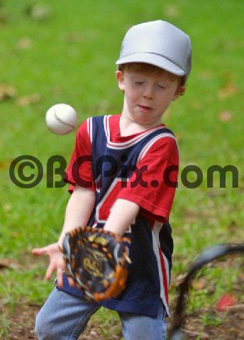 Product picture Little boy catching a baseball